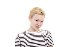 Young woman in striped tee shirt. Young woman in striped tee shirt posing emotionally on white background. Isolated image, Studio shot on white background Royalty Free Stock Images