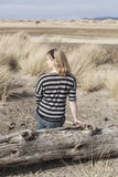 Young Woman in Striped Top at the Beach Royalty Free Stock Photography