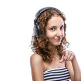 Young woman in striped vest with headphones Royalty Free Stock Photos