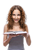 Young woman in striped vest with red book Royalty Free Stock Photo