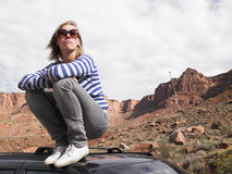 Young Woman in Stripped Shirt on Roof of Car Stock Photos