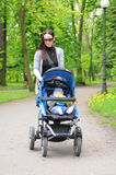 Young woman with a stroller Royalty Free Stock Image