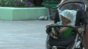 Young woman with a stroller on the street of Varna in Bulgaria. Varna - the sea capital of Bulgaria, a center of shipping and tourism. Today it is the third stock video