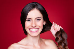 Young woman with strong hair Stock Photography