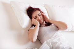 Young woman with strong headache Royalty Free Stock Image