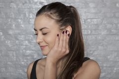 Young woman struggles with earache royalty free stock photo