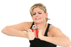 Young Woman Struggling with Hand Grips Royalty Free Stock Images