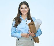 Young Woman Student architect holding blueprints. Smiling girl  portrait Stock Photography