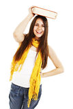 Young woman (student) with book on her head Royalty Free Stock Photos