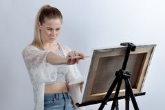A young woman or a student enjoys creative painting drawing. She Royalty Free Stock Photos