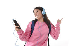 Young woman or student girl with mobile phone listening to music headphones singing and dancing Stock Photography