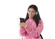 Young woman or student girl with mobile phone listening to music headphones singing and dancing Royalty Free Stock Photo