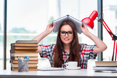 The young woman student with many books Stock Images