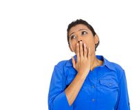 Young woman, student placing hand on mouth yawning Royalty Free Stock Photography