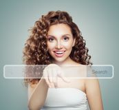 Young woman student pointing to empty address bar in virtual web browser. Seo, internet marketing, www or distance learning. Concept stock photography