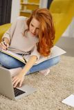 Young woman or student working at home royalty free stock photos