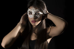 Young woman ,studio portrait. Young woman with mask ,studio portrait on black background royalty free stock image