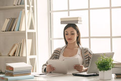 Young woman study at home alone education Stock Photos