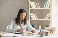 Young woman study at home alone education. Young woman study at home alone reading a book Royalty Free Stock Photo