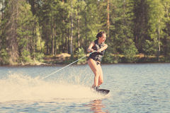 Young woman study riding wakeboarding on a lake Royalty Free Stock Photos