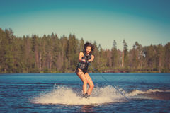 Young woman study riding wakeboarding on a lake Stock Image
