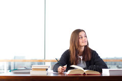Young woman studying Royalty Free Stock Photos