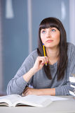 Young woman studying. In a modern classroom Royalty Free Stock Images