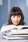 Young woman studying. In a modern classroom Royalty Free Stock Photography