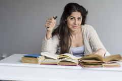 young woman  studying with books for exams Royalty Free Stock Image