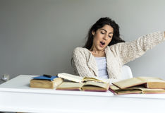 Young woman  studying with books and yawning Stock Photography