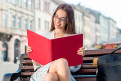Young woman studying in the city Stock Images