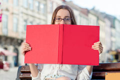 Young woman studying in the city Stock Photo