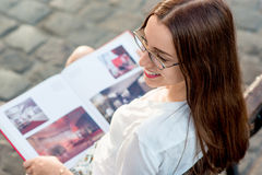 Young woman studying in the city Royalty Free Stock Photo