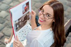 Young woman studying in the city Stock Photography
