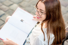Young woman studying in the city Royalty Free Stock Photography