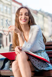 Young woman studying in the city Royalty Free Stock Images
