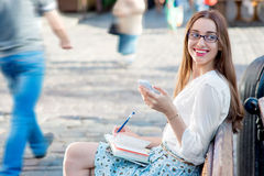 Young woman studying in the city Royalty Free Stock Image
