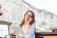 Young woman studying in the city Royalty Free Stock Photos
