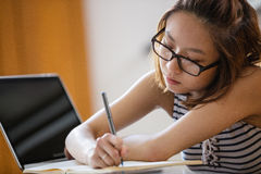 Young woman studying in classroom Royalty Free Stock Photo