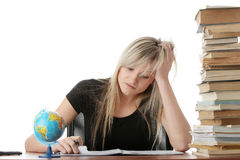 Young woman studying at the desk Royalty Free Stock Photography