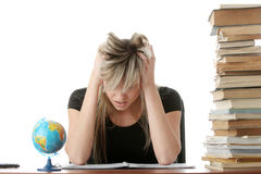 Young woman studying at the desk Royalty Free Stock Image