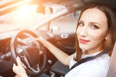 Young woman studying driving car in school Royalty Free Stock Photos
