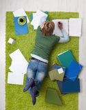 Young woman studying on floor Stock Image