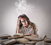 Young woman studying hard royalty free stock photo