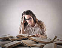 Young woman studying hard Royalty Free Stock Photos