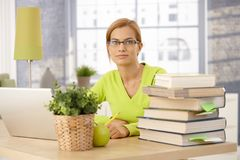 Young woman studying at home Stock Photography
