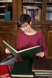 Young woman studying in the library Royalty Free Stock Photography