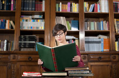Young woman studying in the library Stock Image