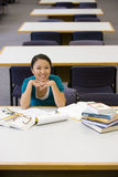 Young woman studying in library, smiling, portrait, elevated view Stock Photo