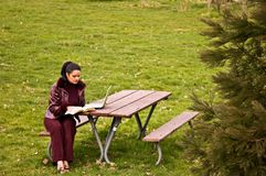 Young Woman Studying at Park with Laptop Royalty Free Stock Images